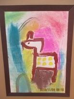 キリンを描いた後、コンテで色をつけ、指でこすると広がることに気がつきました。自分なりの表現の仕方でキリンを表現していきました